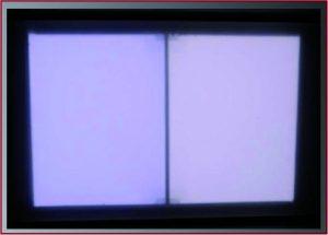 Referenzleuchte mit zwei nebeneinander liegenden, homogen leuchtenden Flächen. Jede Fläche ist getrennt über vier Farbkanäle steuerbar. Damit lassen sich unterschiedliche Farben bzw. Spektren realisieren. (Bild: Büchner Lichtsysteme GmbH)