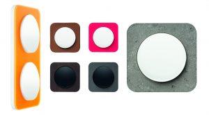 Die ganze Materialvielfalt des Schalterprogramms R.1: Beton, Schiefer, Holz, Leder, Acryl in Orange und in Rot. (Bild: Hager Vertriebsgesellschaft mbH & Co. KG)