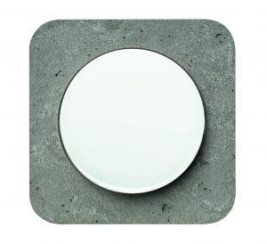Beispiel Beton - eine runde Sache: Die schlichte weiße Wippe et einen wirkungsvollen Kontrast zum individuellen Betonrahmen. (Bild: Hager Vertriebsgesellschaft mbH & Co. KG)