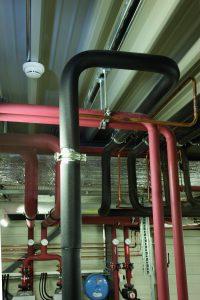 Eine parametergestützte Branddetektion mit punktförmigen Meldern liefert in Produktionsbereichen gute Ergebnisse für geringe und mittlere Raumhöhen. (Bild: Siemens AG)
