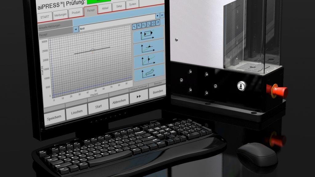 aiPress mit automatischer Schutzhaube und der Bediensoftware aiQ-Control