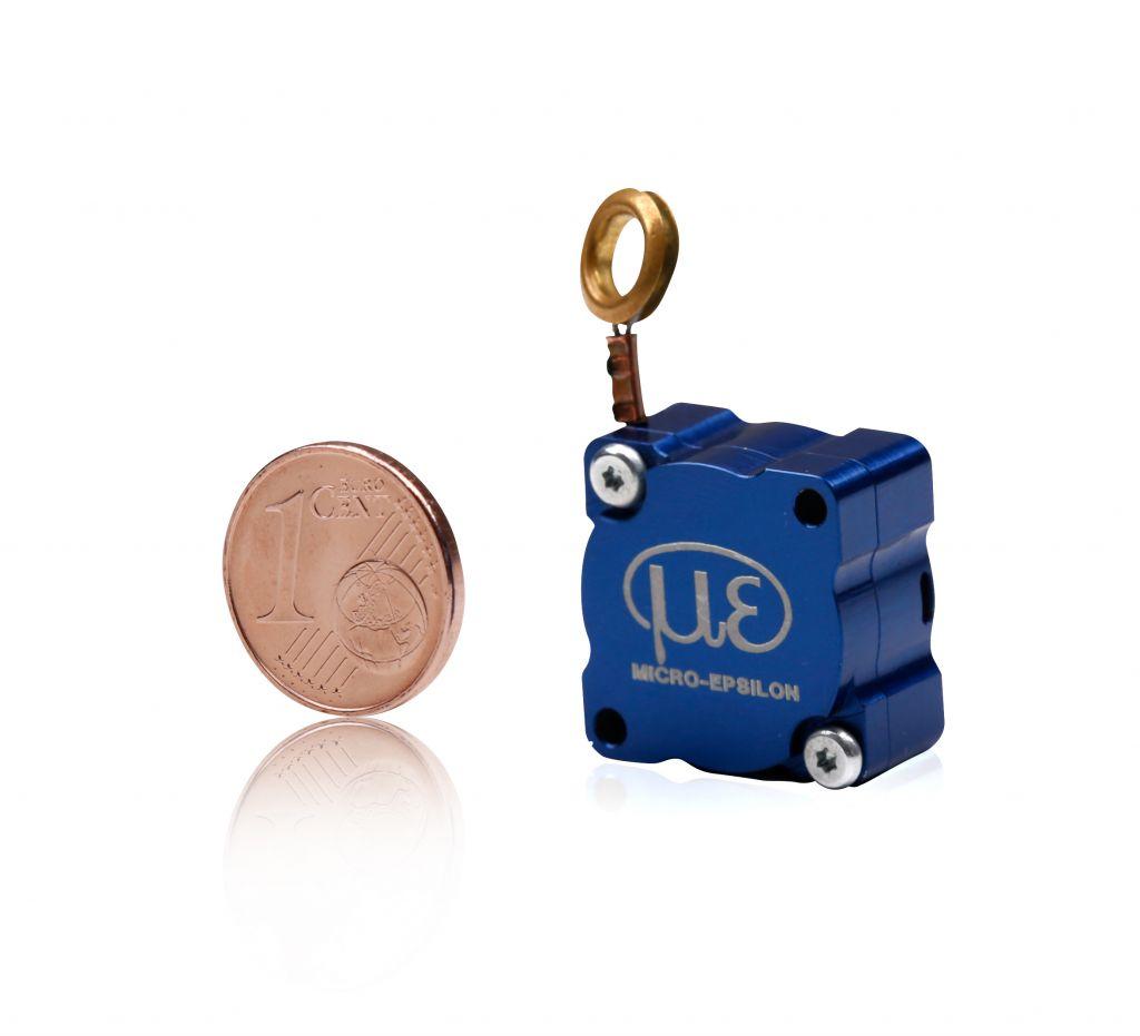 Der neue Miniatur-Seilzugsensor MT19 ist gerade so klein wie eine 1-Cent-Münze und damit derzeit einer der kleinsten Seilzugsensoren weltweit.