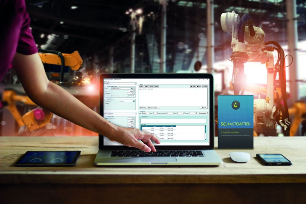 Engineer touching laptop check and control welding robotics automatic arms machine in intelligent factory automotive industrial with monitoring system software. Digital manufacturing operation.Industry 4.0